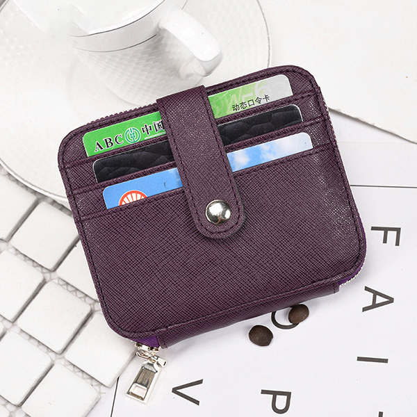 Details: Material Genuine Leather Color Black, Blue, Purple, Coffee Weight 100g Length 11cm (4.33'') Height 9.5cm (3.74'') Width 1.8cm (0.71'') Inner Pocket 12 Card Slots, 1 Zipper Slot Closure Zipper Package Include: 1*Bag More Detials: #purse