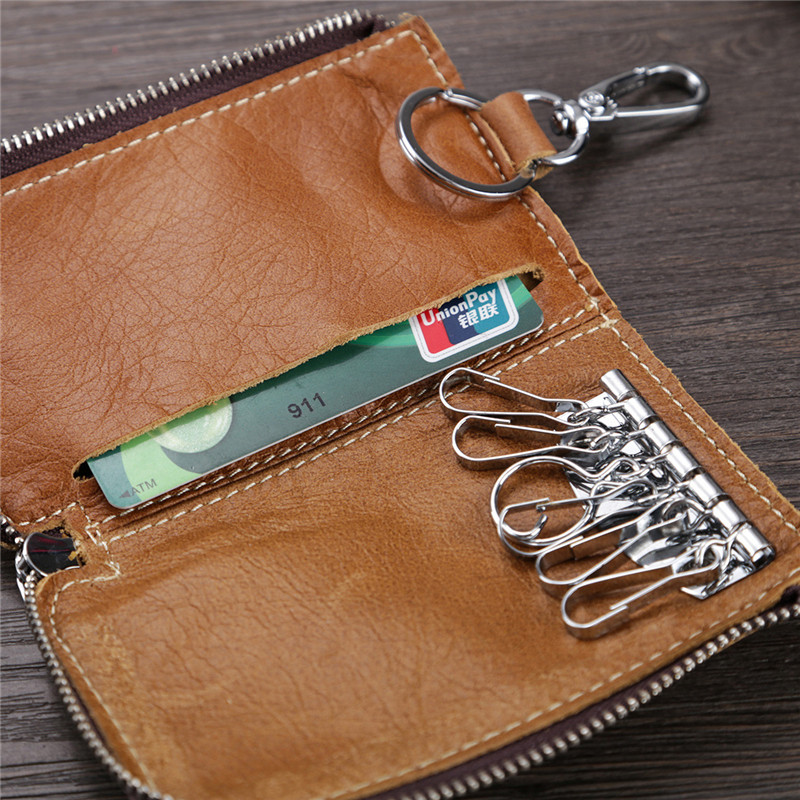 Details: Material Genuine Leather Color Black, Purple, Wine Red, Brown, Pink, Coffee, Yellow Weight 90g Length 10cm (3.94'') Height 6cm (2.36'') Pattern Solid Inner Pocket 6*Key Holder, 1*Card Holder Closure Zipper Package include: 1*Bag More Details: #purse