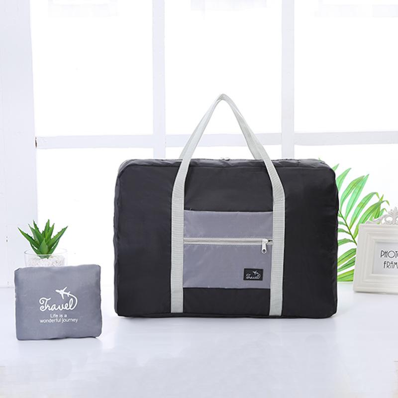 Korean version of the portable clothing luggage bag travel