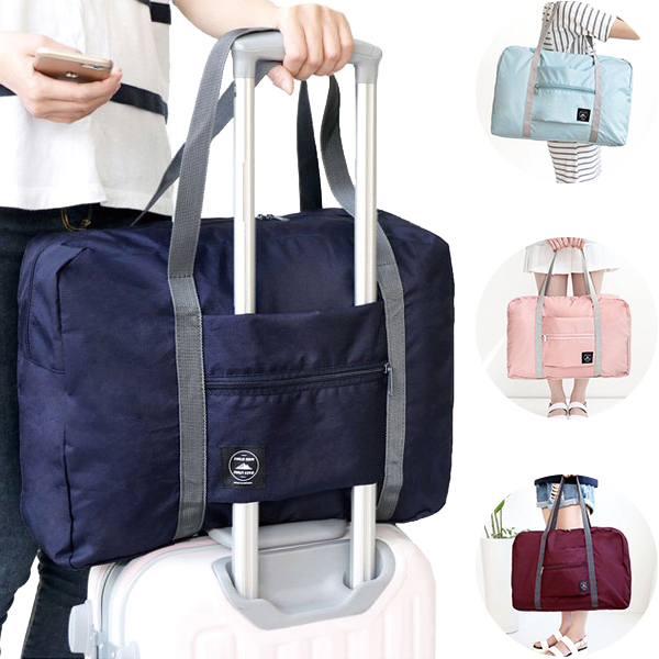 Specification: Material Polyester Color Light Blue, Dark Blue, Wine Red, Pink Unfolded size 48 x 32 x 16cm/18.9 x 12.6 x 6.3inch Folded size 21 x 18cm/8.27 x 7.09inch Weight 140g Package Included : 1 x Travel Bag #handbag