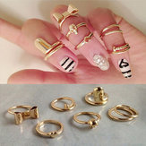 7pcs Gold Alloy Heart Bowknot Skull Joint Ring Nail Ring