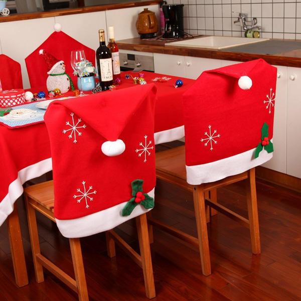 Il fiocco di neve di Natale il posto di pranzo di cucina di copertura di sedia di cappello rosso indietro copre la decorazione del partito familiare