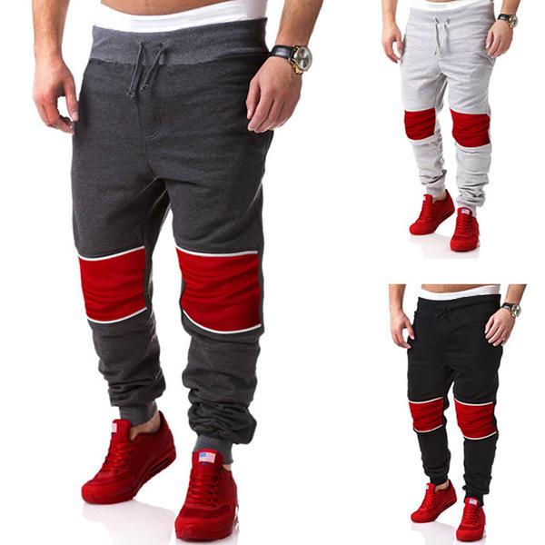 Magliette casuali di cucito degli uomini di Jogger di sport che fanno funzionare i pantaloni di scarsità di cotone allentati