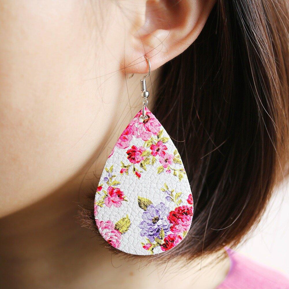 Boucle d'oreille en forme de fleur en cuir PU pour femme