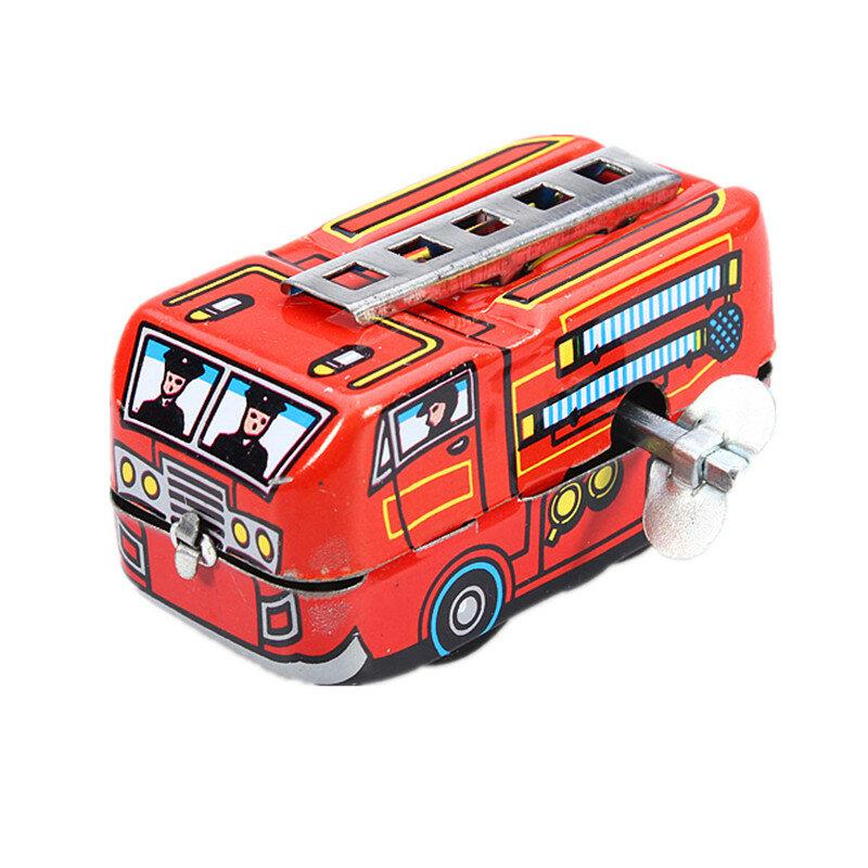 Jefe de bomberos de la vendimia del carro del coche de bomberos de relojería terminan juguetes de hojalata