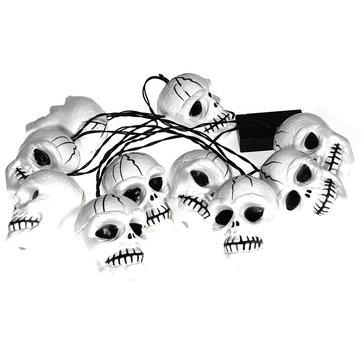 Le ossa piene di colore tendono la lampada di teste di cranio di vigilia d'Ognissanti di luci